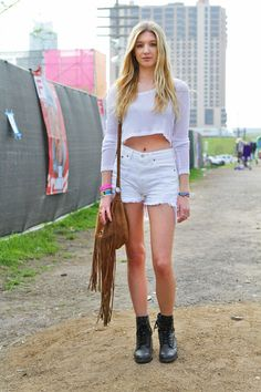 Hannah Kocurek, a local off to catch the ASAP Rocky performance, wears a Free People top and Urban Outfitters shorts.   - ELLE.com