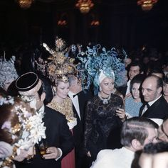 Grace of Monaco at the Bal des Têtes 1956 - hosted at the Lambert by Baron Alexis de Redé - with headdresses designed by Yves Saint Laurent