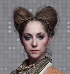 A medium brown straight avant garde sculptured plaited hairstyle by PS Hairdressing