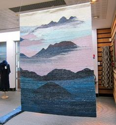 Tapestry woven and naturally dyed by Wen Chi Wu (Taiwan) in the exhibition hall at ISEND.]