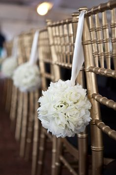 love this hanging chair decor. Do this in any color by making the streamer flowers instead of fresh.