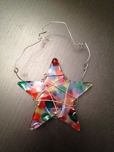 Melted Bead Sun catcher- or an ornament for your tree? Pony beads melted inside a metal cookie cutter. Crafts To Do, Holiday Crafts, Crafts For Kids, Arts And Crafts, Fun Activities For Kids, Motor Activities, Sensory Activities, Melted Bead Crafts, Pony Bead Crafts