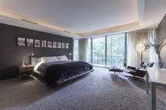 403 Westminster Dr Houston, TX 77024: Photo  Master Suite features carpet with broadloom design by Carol Piper rugs, His and Her closets with installed Program Martin system, and windows that lead to outdoor patio with amazing views of backyard and bayou!