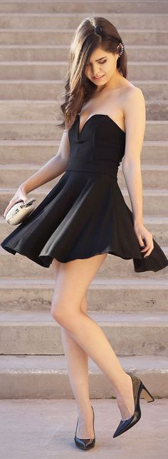 Amazing LBD and stiletto heels.  Just watch the heads turn.