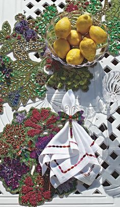 Set the most magnificent table with the Garden of Eden Collection. This stunning collection from Kim Seybert celebrates nature's splendor with intricate beadwork and lustrous colors.