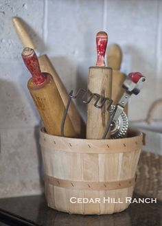 I keep my rolling pins next to the stove too ! Love her basket.  Adorable ! (from Cedar Hill Ranch)