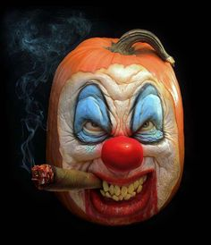 Everybody loves a clown! A clown face carved out of a pumpkin by Ray Villafane and his team for Halloween