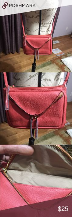 NWT Crossbody Bag by a.n.a. This is a very nice NWT crossbody bag by a.n.a in the color apple.  It is not really red but a red-orange color. a.n.a Bags Crossbody Bags