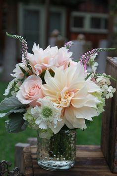 Floral arrangement of dahlias and roses, pink veronica, scabiosa.