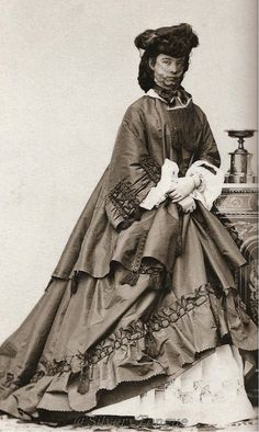 Empress Elisabeth looks at the camera while wearing a hat and outdoor veil in this photo by Angerer.