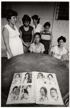 "Eli Reed, Missing Persons Families looking for ""disappeared"" relatives in the ""Book of Missing,"" Human Rights Commission Office, San Salvador, 1982"