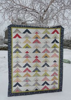 A Reunion Strip Tube Quilt - using a gray dot fabric as her background
