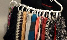Using shower curtains hooks placed on a regular hanger to hang up scarves...brilliant!  I need to make this!!