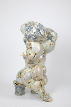 Yeesookyung -  Translated Vase, 2010,  Ceramic trash, epoxy, 24 k gold leaf, 135 x 85 x 85 cm