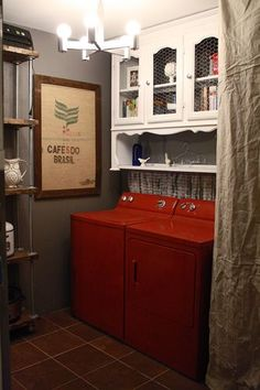 find an old hutch... mount the top piece for a cabinet space over washer & dryer. Love the chicken wire on the doors!