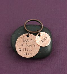 A Boy's First Hero Keychain - DII - Gift For Dad - Fathers Day - New Dad - Handstamped Handmade Gift - 1 5/8 Inch 25.4 15MM Copper Discs - Custom Phrase - Change to Any Name. Dad A Boy's First Hero keychain, personalized with name of your choice by DistinctlyIvy. Perfect gift for Daddy on his birthday - personalized with his little boy's name. Have more than one son? Choose the name disc options to get more than just one added! ------------------------------------------- PRODUCTION TIME...