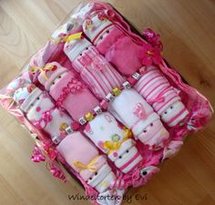 Girl diaper cake with a twist: box with diapers and diaper babies