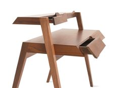 This Primary Desk is an odd sort of fellow with its angles and points and slim drawers. Inspired by mid-century furniture in the designer's childhood, the desk hits a mark somewhere in between clas...