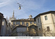 vintage homes in Italy | Milan (Lombardy, Italy) - Old houses and the Cathedral - stock photo