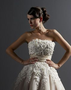 This flirty, strapless, two-tone tulle tea length dress features Venice lace applications and elegant beading detailing on the bodice. A silk dupion sash cinches the waist of this adorable dress. https://www.justinalexanderbridal.com/wedding_dresses/8465