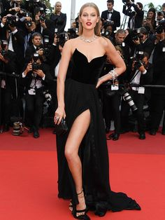 All the Glamour, Glitz and Gowns from the Cannes 2016 Red Carpet | People - Toni Garrn in a black strapless Ulyana Surgeenko dress