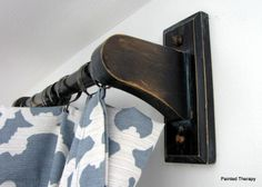 If you have blinds already and just want curtains for decoration, consider using towel bars for curtain rods. Only $5 a pop!