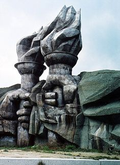 The House of the Bulgarian Communist Party: a statue of a pair of hands holding torches that sits at the bottom of Mount Buzludzha. Thieves have stripped much of the roof panelling away from the main building, which opened in 1981, leaving it vulnerable to the elements. A wall mosaic of Bulgaria's communist dictator Todor Zhivkov has been destroyed, while others of communist heroes Marx, Engels and Lenin remain just about recognisable.
