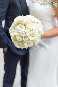 Classic white rose bouquet:  http://www.stylemepretty.com/2016/06/28/the-ultimate-saint-regis-hotel-hotel-wedding/   Photography: Justin & Mary - http://justinandmaryblog.com/