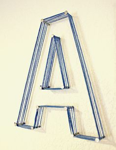 Wall letters with yarn and nails