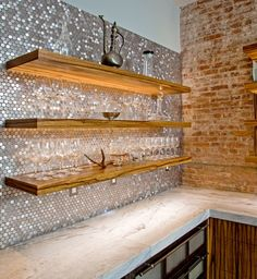 "Penny Tiles add glamorous shimmer to a modern rustic kitchen with a reclaimed-rustic vibe. ""The black limba floating shelves are fitted with recessed LED lighting that highlights the penny tiles and makes them shine Floating Shelf With Drawer, Floating Shelves Bedroom, Floating Shelves Kitchen, Kitchen Shelves, Glass Shelves, Floating Wall, Open Shelves, Wall Shelves, Penny Tile"