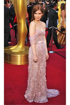 Kate Mara wears a Jack Guisso Couture gown, Lorraine Schwartz jewelry, and Brian Atwood shoes.
