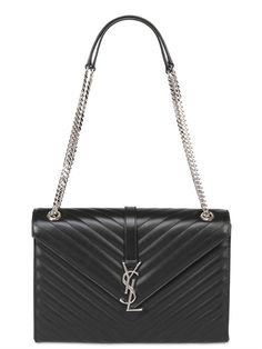 Silver metal YSL monogram and chain straps black leather #bag by Saint Laurent. #classic