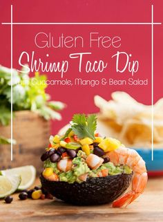 A healthy Gluten Free Shrimp Taco Dip that is layered with Guacamole, Mango…