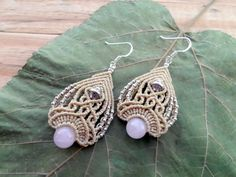 Gorgeous micro macrame earrings with two Rose Quartz and metal beads set in beige wax thread . The earrings are very light and comfortable to wear , the ear hooks are made of Stamped 925 Sterling Silver .