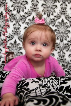 Great child photography.  Love the damask backdrop and that adorable face!