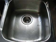 To get rid of the nasty black gunk in your drain & mildew smell: 1. Put a pot of water to boil. 2. Meanwhile pour baking soda down the drain (BS has the ability to neutralize fatty acids so it will eat away the grime) 3. Once boiling remove water & pour down drain. 4. Let the water/BS work at decomposing and sterilizing the grime for 10 min 5. Then pour 1 c bleach down the drain to completely kill any remaining mildew or bacteria.  (repeat every few months)