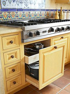 Drawers under a floating cooktop for pots and pans