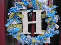 """How to make the wreath for Brooke's room - 4 types of cloth (1/2 yard ea. cut into 2""""x18"""" strips), ribbon (2"""" wide),  straw wreath (18"""") shown in this picture), something to hang from the middle, and a hook"""