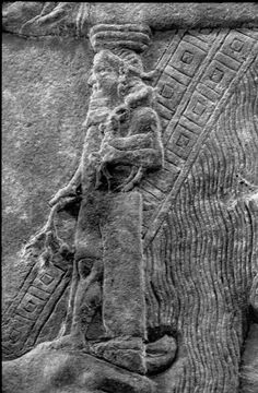 A Neo-Assyrian relief, a detail of a throne carried by one of the attendants, from Dur Sharrukin (Khorsabad), 721-705 B.C.
