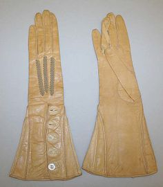 Gloves 1920–39 Culture: French, House of Worth Medium: leather, shell Dimensions: Length: 12 1/2 in. (31.8 cm) Credit Line: Gift of Deborah Barrett, 1979