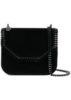Elegantly crafted from sustainable materials, this Falabella Box shoulder bag offers an intriguing take on classic Stella McCartney iconography. Bearing the brand's signature chain trimming in black, this striking shoulder bag has been fashioned in Italy from supple velvet and the designer's eco-friendly faux leather. Practical and stylish, the compact accessory also features, a foldover top with snap closure, an internal slip pocket, an internal logo patch, an engraved charm and a comfor...