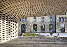 Wooden pavilion by Ramser Schmid built beside Swiss library