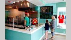 Owner Shawn Wampole chats with customers Carol and Allison Smith at Anna Maria Island Donuts.