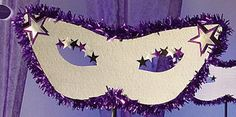 Our Masquerade Masks features a large silver mask cutout decorated with purple twistees and shimmer stars.