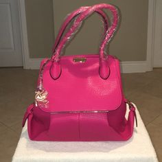 Fuchsia double strap handbag Fuchsia double strapped handbag with small gold hardware. Comes with longer shoulder strap. Super cute! Lots of pockets and storage room. No trades Amy & Joey Bags Hobos