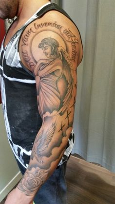 Mens religious sleeve tattoo