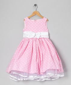 Little ladies will revel in the charming style of this party-perfect dress. Boasting a big bow, easy-on back closure and tie waist, this piece pulls out all the precious stops.Cotton / polyesterDry cleanMade in the USA
