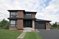 <ul><li>This stately modern house plan features strong geometric lines subtly enhanced by a blend of wood, brick and fiber cement panels. It comes with a one-car garage and a version without the garage is also available.</li><li>Inside, a clean foyer gives you storage space and a powder room plus views to the back of the home.</li><li>Beyond the foyer, light intersects from the living room, dining room and staircase windows ensuring well-lit space...