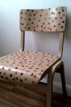I'm not crazy about the pattern on this decoupage chair, BUT the technique is flawless and this is a great way to jazz up an old chair.