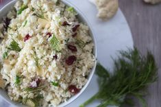 Cauliflower rice goes well with all different types of red and white meats, and also fish. The cranberries in this version give it a sweet yet tart finish – so we love eating it with pork chops or chicken sausages. Dill Recipes, Vegan Recipes, Vegan Food, Broccoli Rice, Cauliflower Rice, Cranberry Almond, Veggie Stock, Love Eat, Chicken Sausage